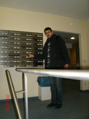 Sheet metal worker Mr Sako Nenejian from Aleppo in Syria - First steps of a professional on the way to his study at the Technical University Berlin - The fixing of the name on the mail box! Berlin Students Hostel  in Januray 6, 2011